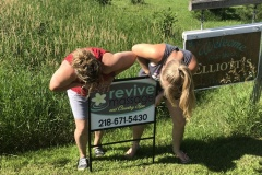 Danielle & Staci putting in our new sign together!